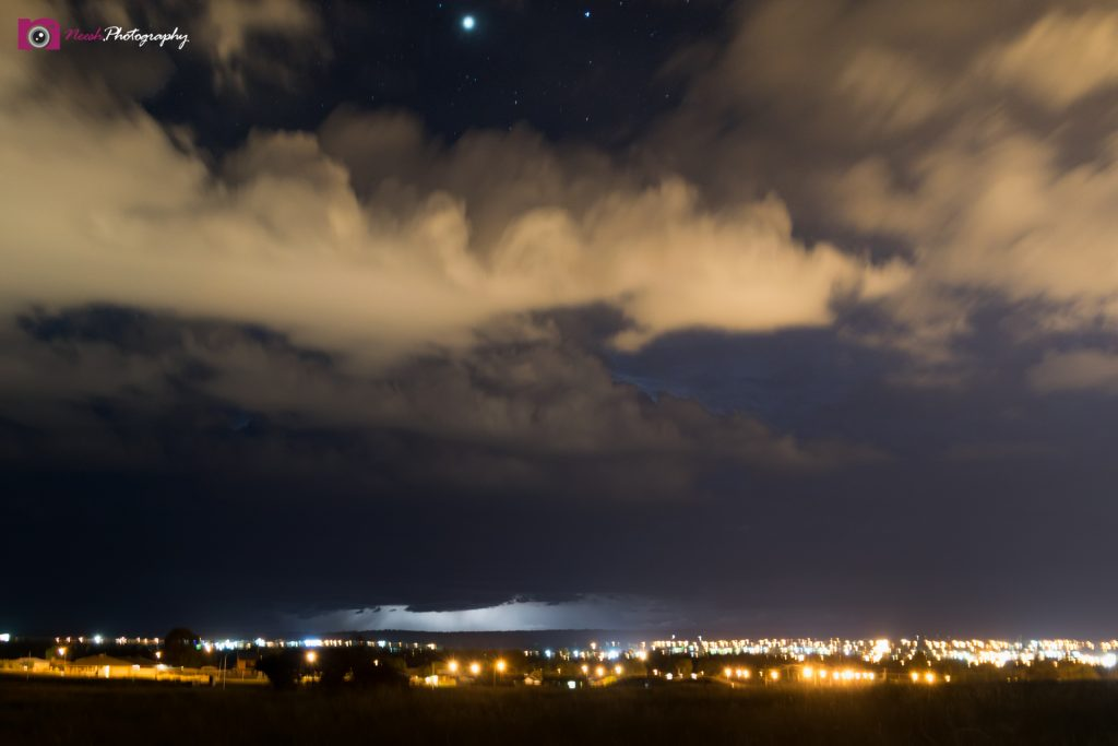 Astrophotography and Storm Chasing – Storm in distance and Stars above Dubbo city lights.