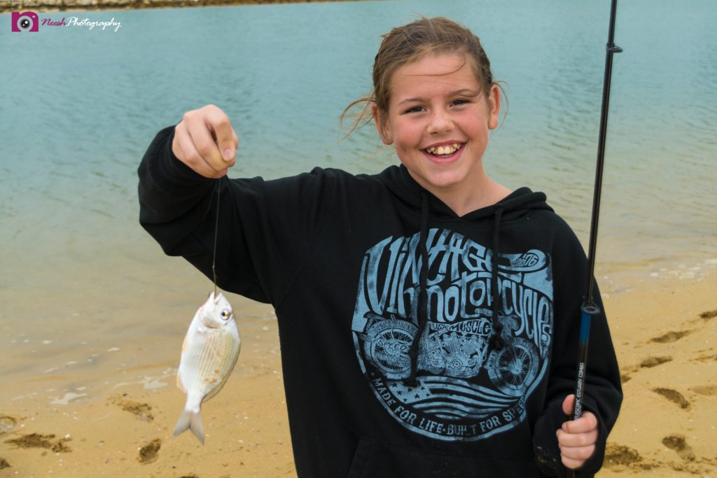 Road Trips - Girl Holding a Fish