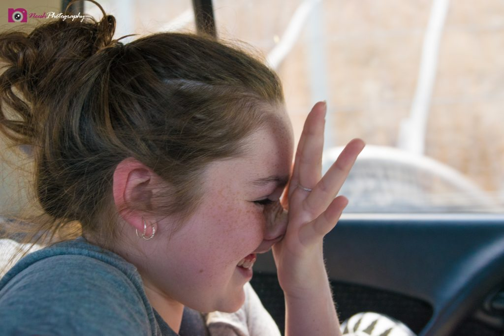 Road Trips - Girl scratching her nose
