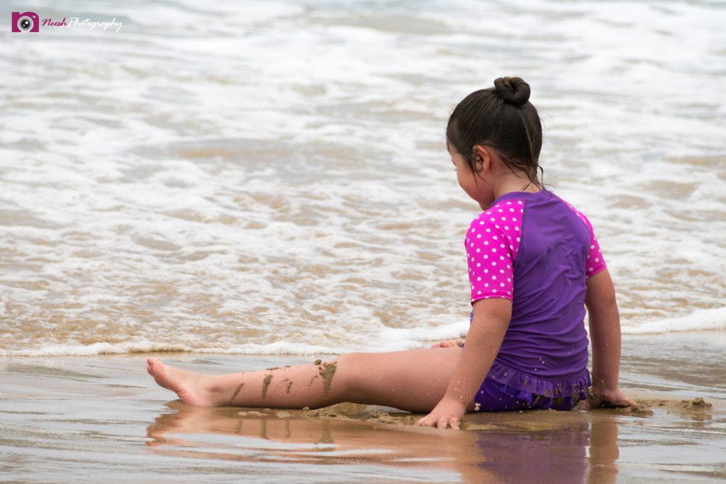 Road Trips - Little girl playing on the beach