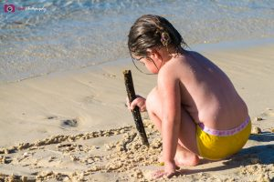 Road Trips - Little girl drawing in the sand
